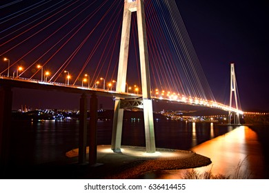 Bay Bridge at night. the lights on the water.