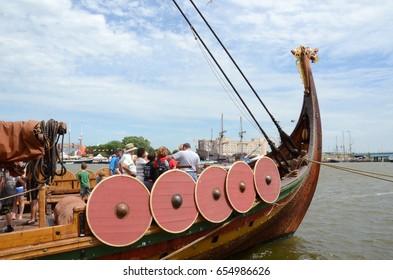 BAY CITY, MI - JULY 17: Visitors explore the viking longship Draken Harald Harfagre at the Tall Ship Celebration in Bay City, MI on July 17, 2016.