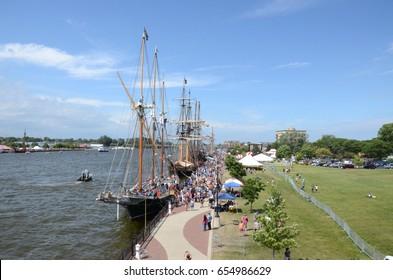 BAY CITY, MI - JULY 17: Visitors explore many of the ships at the Tall Ship Celebration in Bay City, MI on July 17, 2016.