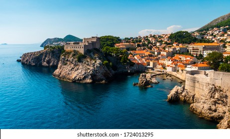 A bay in Croatia with a marina, castle and fort at the foot of the mountain