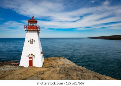 Bay of Fundy coastline and Boar's Head Lighthouse near Tiverton on Long Island, Nova Scotia, NS, Canada
