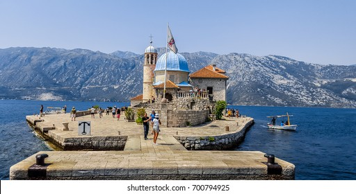 Bay of Kotor, Montenegro, August 11, 2017: The Roman Catholic Church Our Lady of the Rocks on  artificial island in the Adreatic sea.