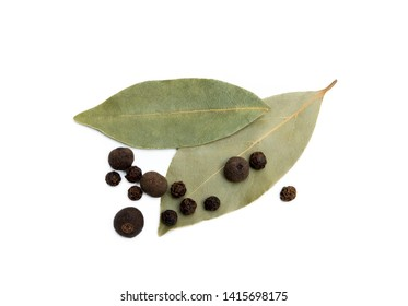 Bay leaf, allspice and pepper isolated on white background