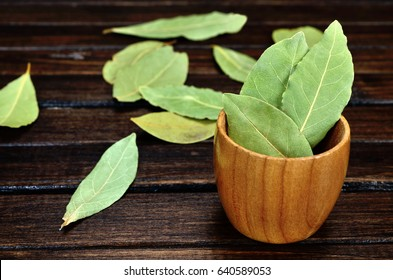 bay leaf dried in bowl on wooden table