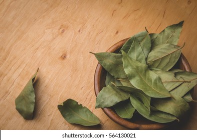 bay leaf on a wooden surface. Top view/spices of bay leaf in rural style. Top view