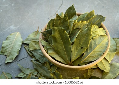 Bay leaves in a clay dish on a concrete worktop - Shutterstock ID 1808552656