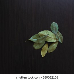 bay leaves on a dark wooden table