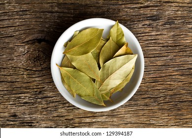 the bay leaves in white ceramic bowl