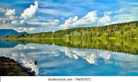 The bay with a mirror on the water level at the Liptovska Mara dam. Trees mirroring on the water level. Summer scenery in Slovakia.