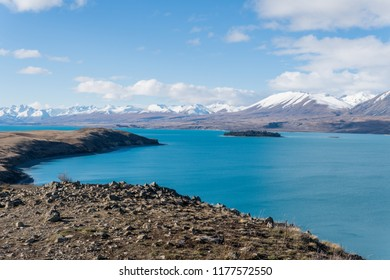 bay and mountains at Lake Tekapo while hiking the trail with island in view