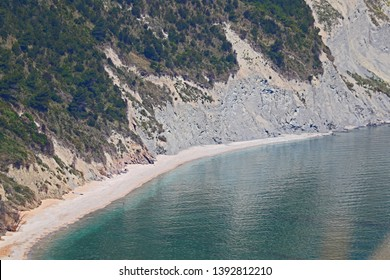 The bay near Portonovo in the province of Ancona in Italy seen from above around Monte Conero on a beautiful spring day with a calm Adriatic sea by Ruth Swan