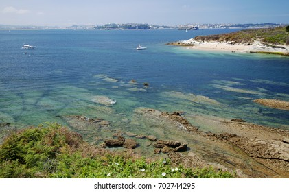 Bay of Satander, Cantabria, Spain, View from the edge of Playa de Loredo towards small island La Isla de Santa Marina