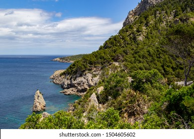 Bay Ses Caletes on the peninsula La Victoria, Mallorca with rocky coastline and turquoise clear water