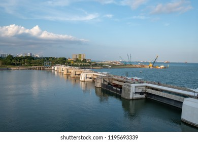 Bay view of the port town of Singapore Small Constanta harbour gateway view. Sea wall for protect the beach. Breakwaters concrete tetra-pods.