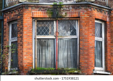 Bay window of an abandoned terrace house around Hornsey in London