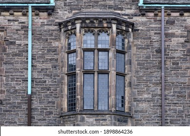 Bay window with leaded glass, on gothic style stone building
