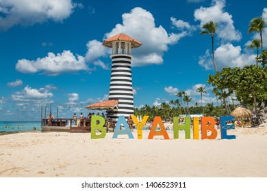 Bayahibe / Dominican Republic - 10 September 2018: Tourists on vacation enjoying Caribbean sea and white sand beach near the lighthouse