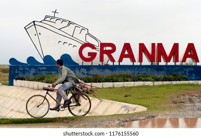 BAYAMO, CUBA- MAY 09, 2016:Biker in front of the Granma memorial. Granma is the yacht that was used to transport the fighters of the Cuban Revolution from Mexico to Cuba in 1956