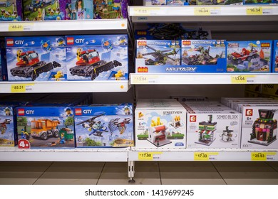 Bayan Lepas, Pulau Pinang, Malaysia - June 8 2019: Authentic Lego brick sets sell on the rack with Lego clone sets or imitation products at Tesco in Asia countries.