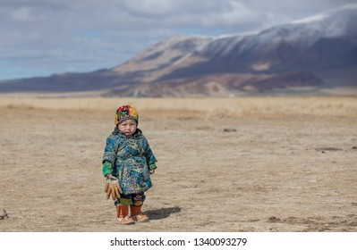 bayan Ulgii, Mongolia, 29th September 2015: mongolian kazakh nomad boy playing in a landscape of western mongolia