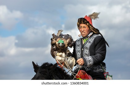 bayan Ulgii, Mongolia, 4th October 2015: kazakh eagle hunter in a landscape of western Mongolia