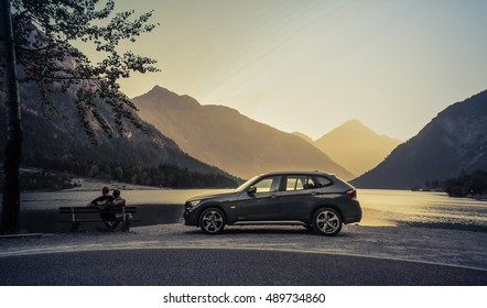 Bayern, Germany, September 10, 2010 BMW X1 on the shores of an Alpine lake, the BMW X1 is a compact four wheel drive off road and sport utility vehicle