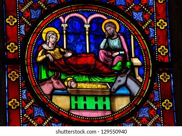 BAYEUX - FEBRUARY 12: Stained Glass window depicting a Nativity Scene, in Bayeux, Calvados, France on February 12, 2013.