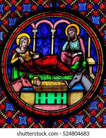 BAYEUX, FRANCE - FEBRUARY 12, 2013: Stained Glass window in the Cathedral of Bayeux, France, depicting a Nativity Scene at Christmas.