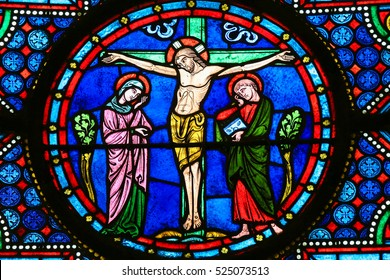 BAYEUX, FRANCE - FEBRUARY 12, 2013: Stained Glass window in the Cathedral of Bayeux, France, depicting Jesus on the Cross