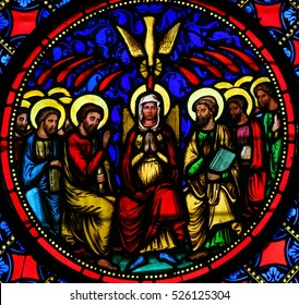 BAYEUX, FRANCE - FEBRUARY 12, 2013: Stained Glass window in the Cathedral of Bayeux, France, depicting Mother Mary and the Apostles at Pentecost