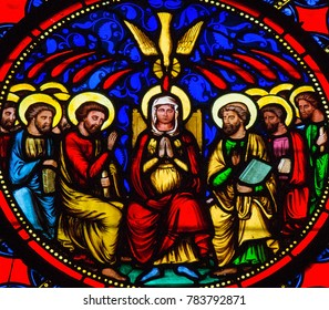 Bayeux, France - February 12, 2013: Stained Glass window depicting Pentecost, in Bayeux Cathedral, Calvados, France.