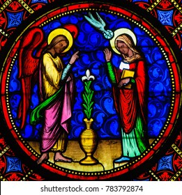 Bayeux, France - February 12, 2013: Stained Glass window depicting the Annunciation, in Bayeux Cathedral, Calvados, France.
