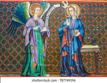 Bayeux, France - February 12, 2013: Mural fresco in the Cathedral of Bayeux, France, depicting the Annunciation with Mother Mary and the Archangel Gabriel