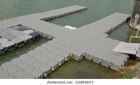 Bayfront Ave, Singapore- Aug 2, 2019: The plastic floating platform is interconnected and used as a dock on water to allow tourists to walk on it to the coastal park area after alighting from a boat.