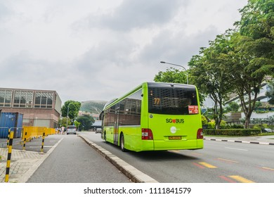 Bayfront Ave., Singapore / Singapore - June, 11, 2018: A green SBS Bus plying the roads of Singapore