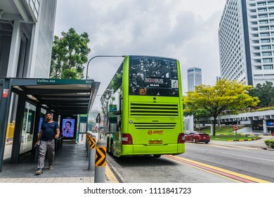Bayfront Ave., Singapore / Singapore - June, 11, 2018: A green SBS Bus at a Bus Stop in Singapore