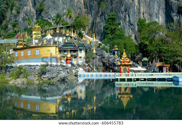 Bayin Nyi (Begyinni) Complex  in Hpa-An, Myanmar. Buddhist monastery and lots of golden stupas reflecting in the water of the sacred lake.