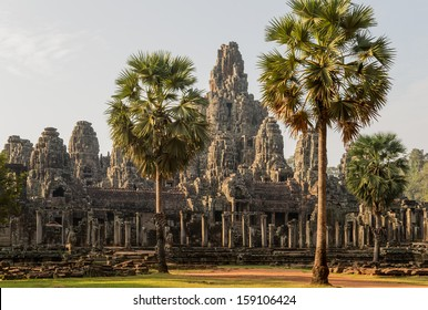 Bayon, one of the best known and most impressive temples of the archaeological site of Angkor  in Cambodia, in the light of the rising sun