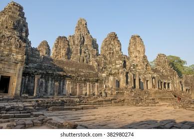 The Bayon temple in Angkor Thom city  built by  King Jayavarman VII 1190-1210,  With the evening light illuminating the dramatic towers and smiling faces of Avalokiteshvara.  Cambodia