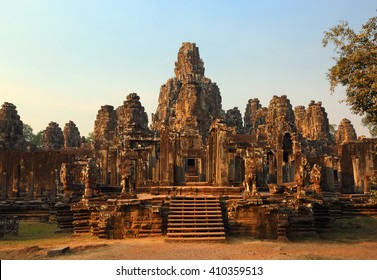 Bayon Temple with giant stone faces at sunset, Angkor Wat, Cambodia