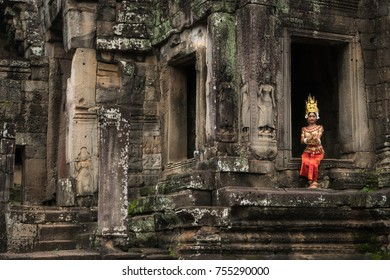 Bayon temple, Siem Reap, Cambodia - October 27, 2017 : Apsara dancer sitting in one of the windows of the old temple complex