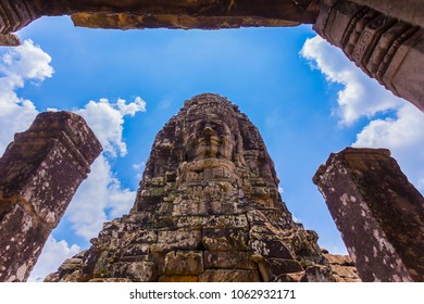 Bayon temple. The Bayon is a well-known and richly decorated Khmer temple at Angkor in Cambodia.  ancient stone temple. Bayon is one of the UNESCO world heritage at Angkor in Cambodia.