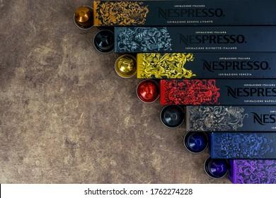 Bayonne, France. 23.06.2020. Nespresso cafe for decoration design. Dark brown background. Wooden background. Store label.