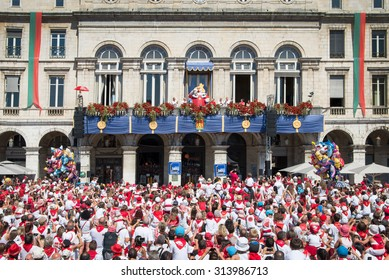 BAYONNE, FRANCE - AUGUST 2: Crowd of people dressed in white and red cheering King Leon on the balcony  at the Summer festival of Bayonne (Fetes de Bayonne), on August 2, 2015 in Bayonne, France