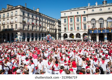 BAYONNE, FRANCE - AUGUST 2: Crowd of people dressed in white and red at the Summer festival of Bayonne (Fetes de Bayonne), on August 2, 2015 in Bayonne, France