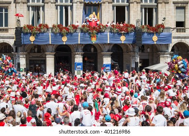 BAYONNE, FRANCE - AUGUST 2: Crowd of people dressed in white and red cheering King Leon on the balcony  at the Summer festival (Fetes de Bayonne),  on August 2, 2015 in Bayonne