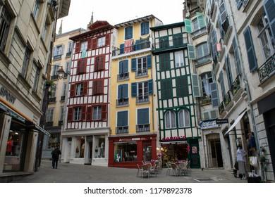 BAYONNE, FRANCE - CIRCA MARCH 2017: Unidentified people walk through the neighbourhood of Grand Bayonne