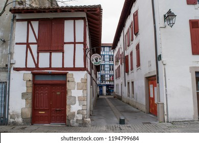 BAYONNE, FRANCE - CIRCA MARCH 2017: Empty streets between half-timbered houses in the city's Old Town