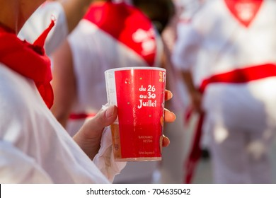 "BAYONNE, FRANCE - JULY31: Unknown people dresses in traditional red and white clothes at ""Fetes de Bayonne"" festivals in the Northern Basque Country in the town of Bayonne, France on July 31st, 2017"