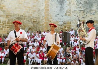 "BAYONNE, FRANCE - JULY31: Unknown people dresses in traditional red and white clothes in ""Fetes de Bayonne"" festivals in the Northern Basque Country in the town of Bayonne, France on July 31st, 2017"